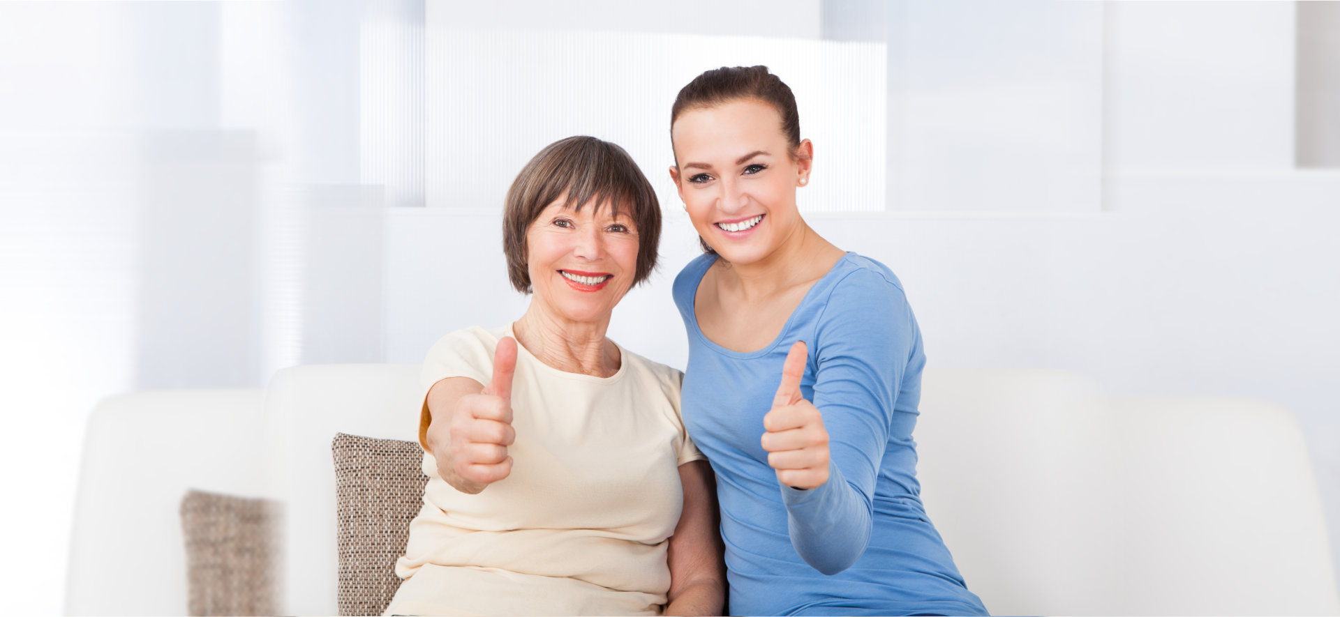 caregiver and patient doing thumbs up